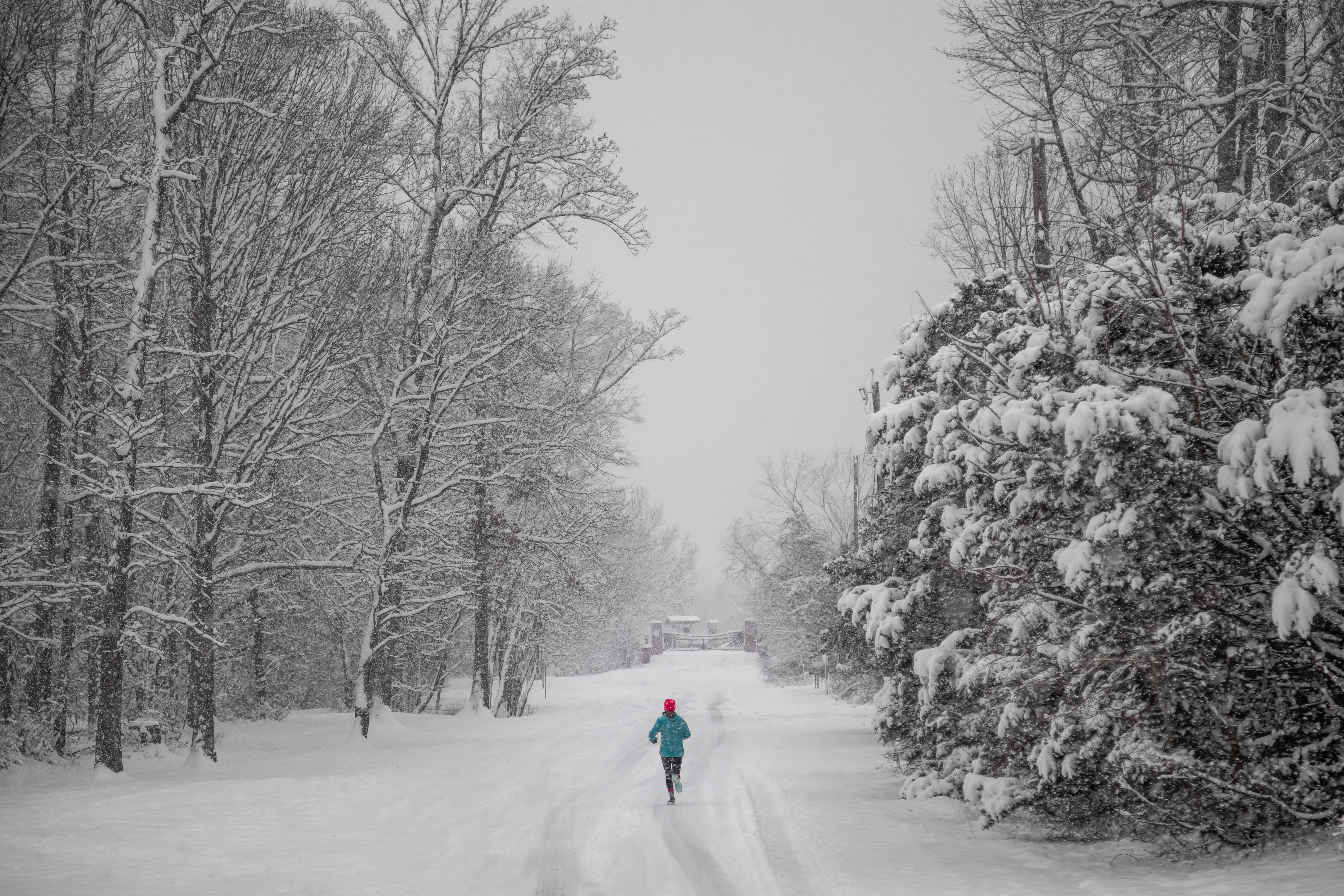 person running on a snowy path